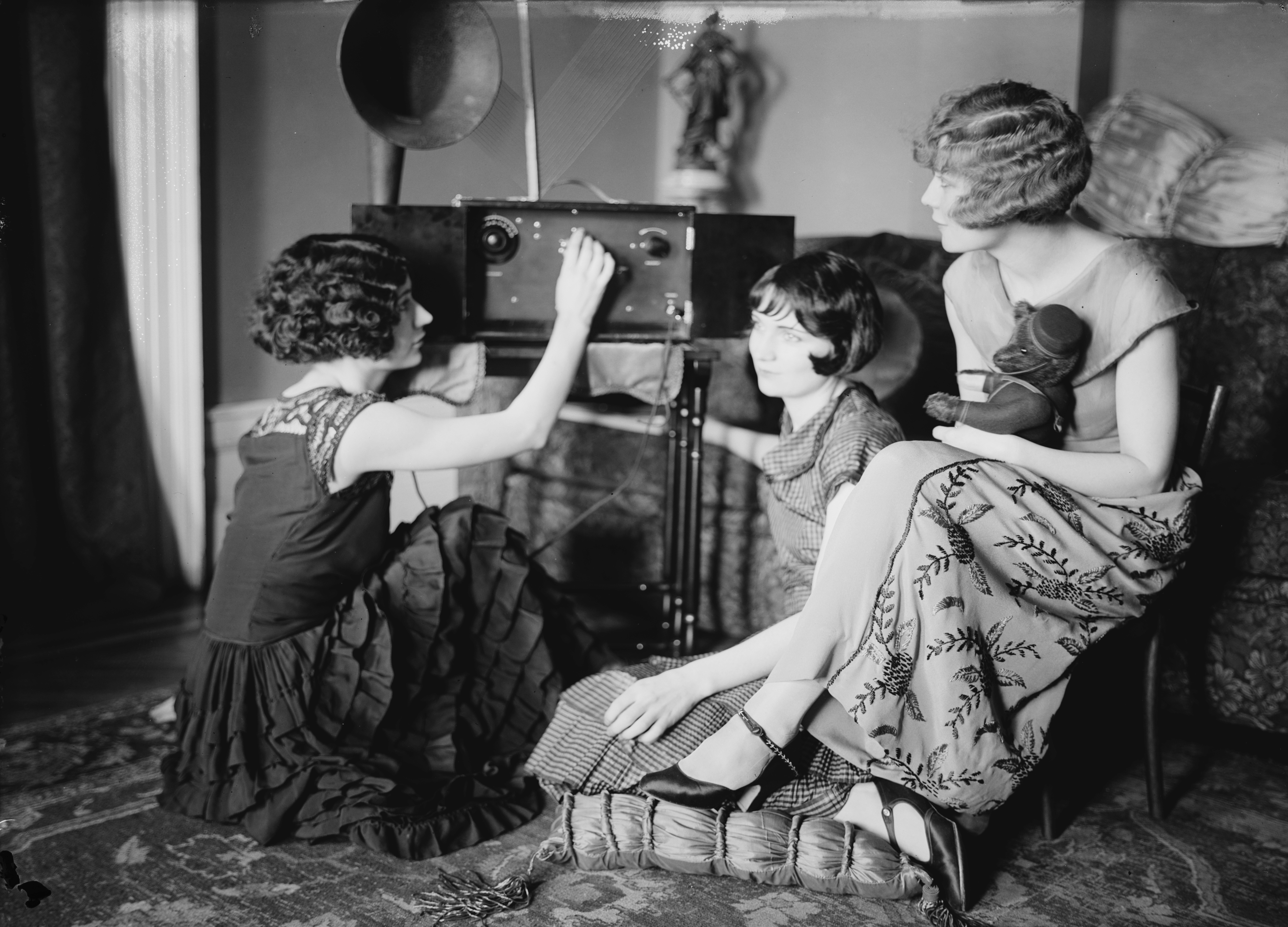 The Brox Sisters, tuning a radio. Left to right, Patricia, Bobbe, Loryane..jpg